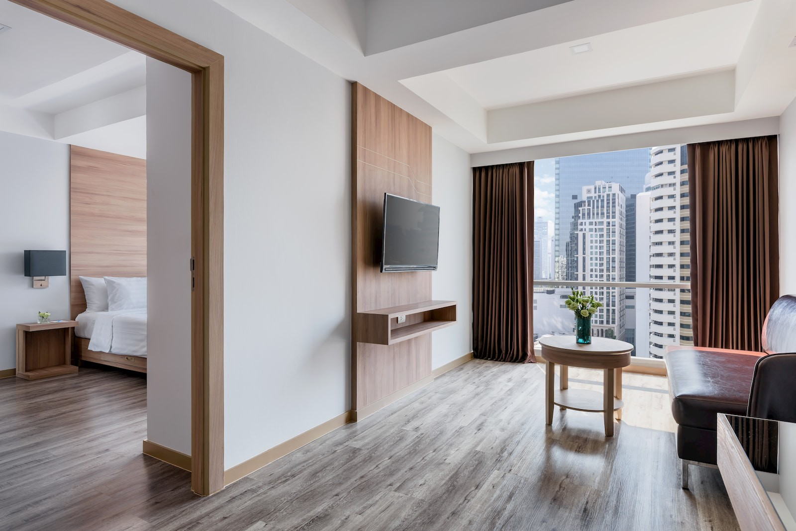 Adelphi Grande Sukhumvit Hotel - Junior Suite Living Area-02.jpg
