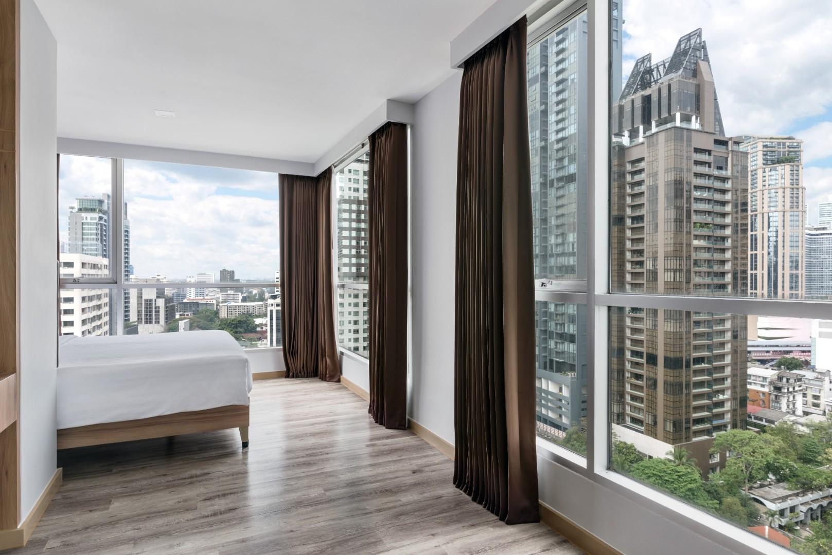 Adelphi Grande Sukhumvit Hotel - Deluxe Suite C Bedroom daytime-07.jpg