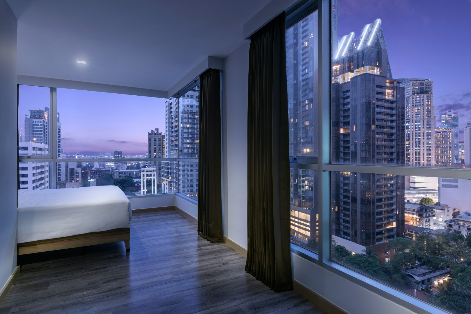 Adelphi Grande Sukhumvit Hotel - Deluxe Suite C Bedroom nighttime-07.jpg