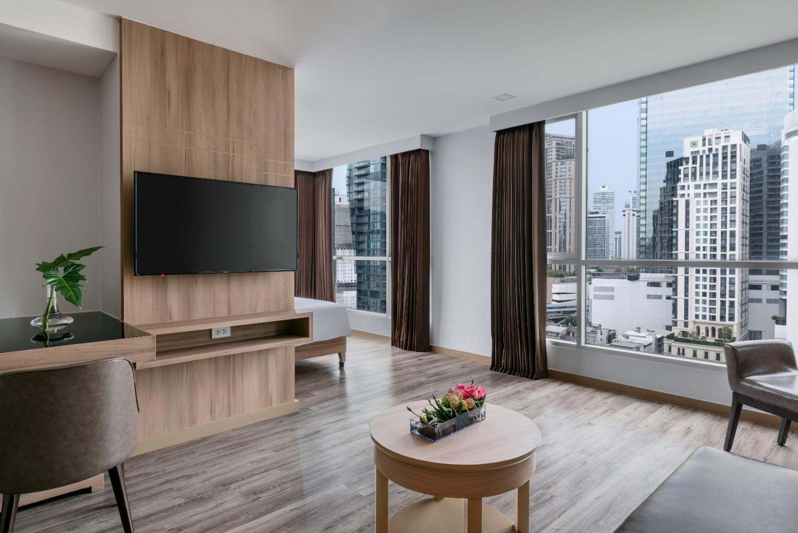 Adelphi Grande Sukhumvit Hotel - Deluxe Suite C Living Area-07.jpg